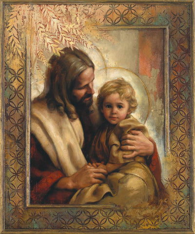 Jesus holding a young child on his lap.