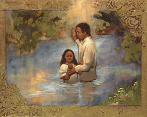 Young girl dressed in white being baptized.