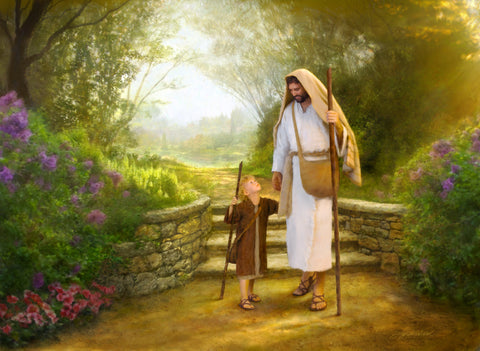 Young boy looks up at Jesus as they walk a path together