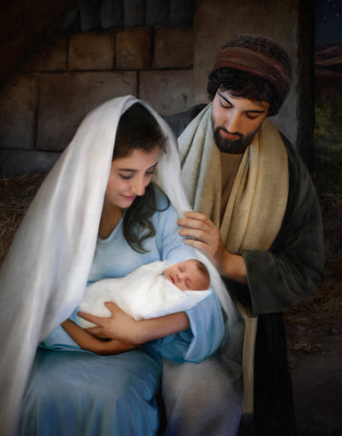 Mary and Joseph holding baby Jesus.