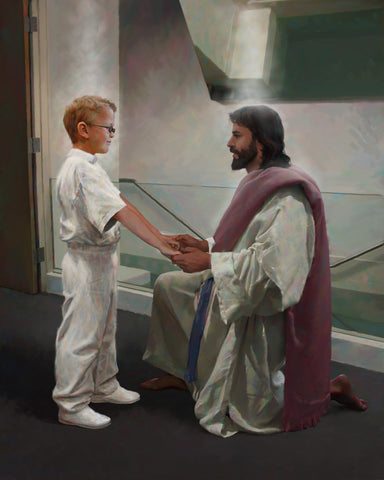 Boy dressed in white in front of a baptismal font with Jesus holding her hands.