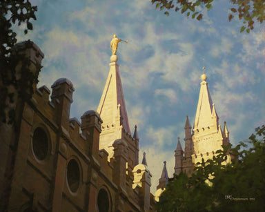 Looking up at Salt Lake temple spires, image of Jesus in the clouds.