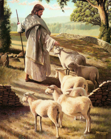 Jesus walking on path with sheep following him.