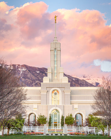 Mount Timpanogos Temple from the front with colorful clouds over the mountain.