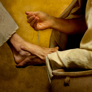 A woman washing the feet of Jesus Christ.