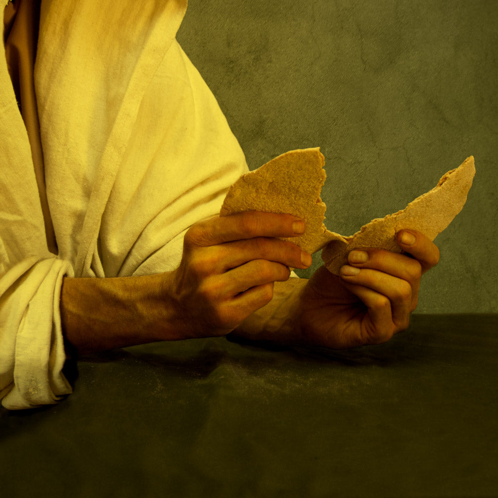 Jesus Christ breaking bread for the sacrament.
