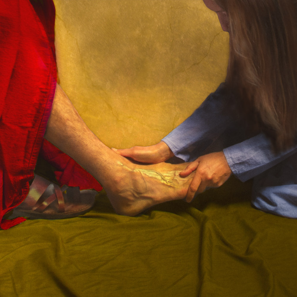 Mary anointing Christ's feet with oil.