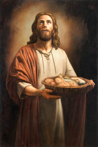 Jesus Christ holding a basket of loaves and fishes.