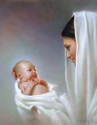 Women with white shall on her head looking at baby she is holding.