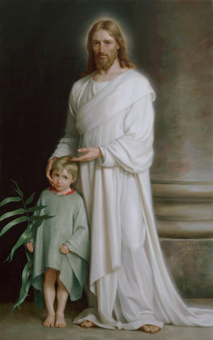 Jesus standing in a white robe with boy holding palm leaf next to him.
