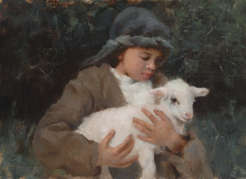 Young shepherd holding a white lamb.