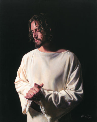 Portrait of Jesus with hands together against a black background.