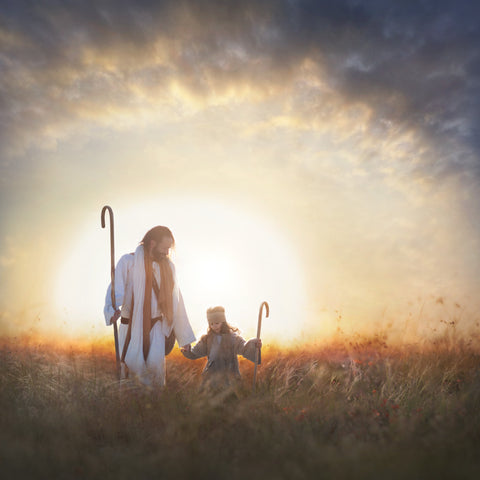 Jesus and a young shepherd holding hands walking in field.