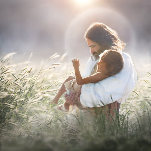 Jesus holding young boy in wheat field.