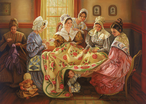 Emma Smith and a group of women work on a quilt together.
