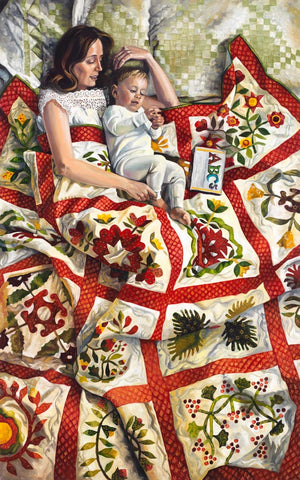 A mother and young child lay with a quilt and a book.