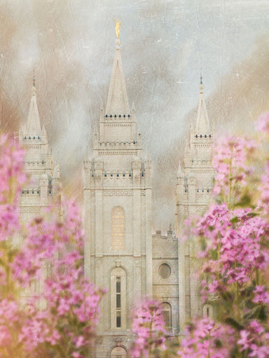 Salt Lake Utah Temple with pink blossoms.