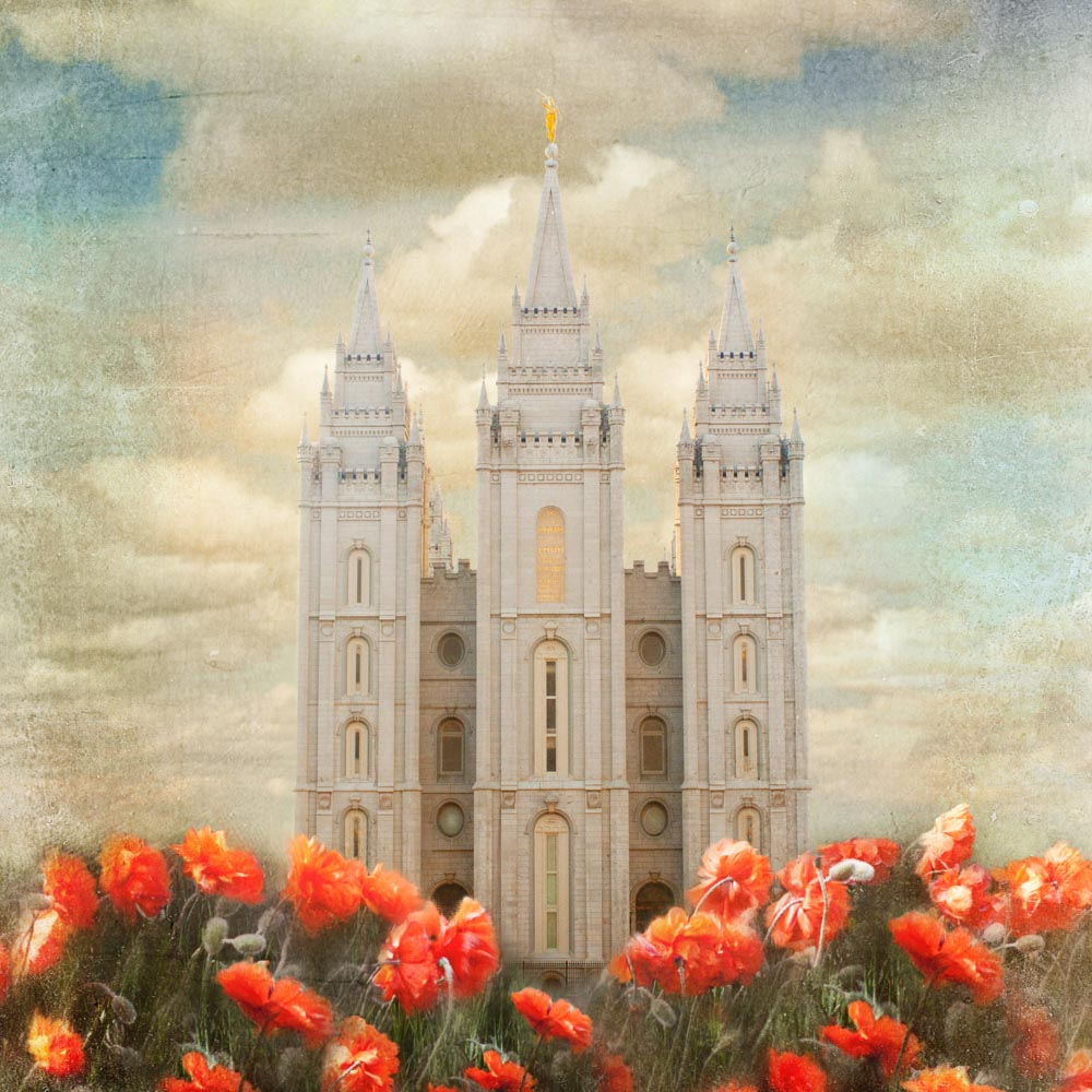 Salt Lake Utah Temple with red tulips in front.
