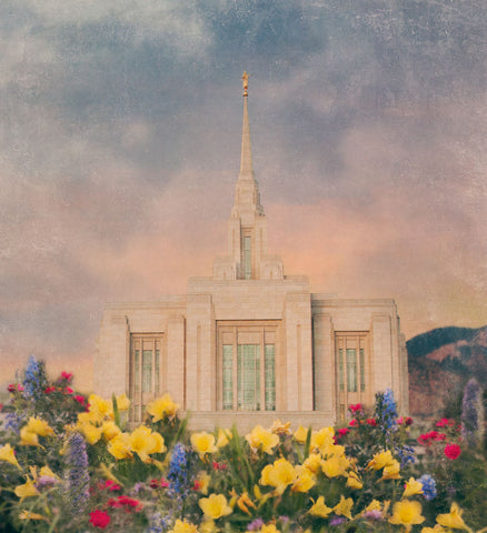 Ogden Utah Temple with blue and yellow flowers.