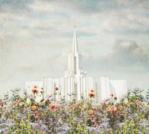 Jordan River Utah Temple with purple and orange flowers.