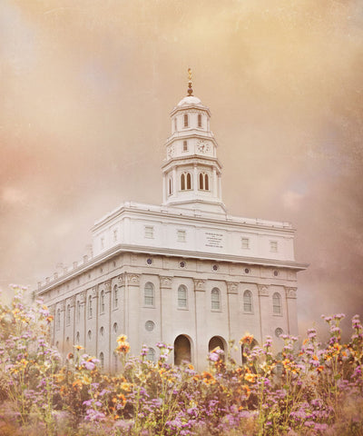 Nauvoo Illinois Temple with yellow and purple flowers.