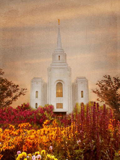 Brigham City Utah Temple with orange and red fall flowers.