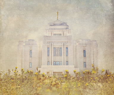 Meridian Idaho Temple with yellow flowers.