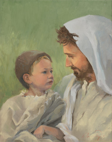 Jesus holding a young boy.
