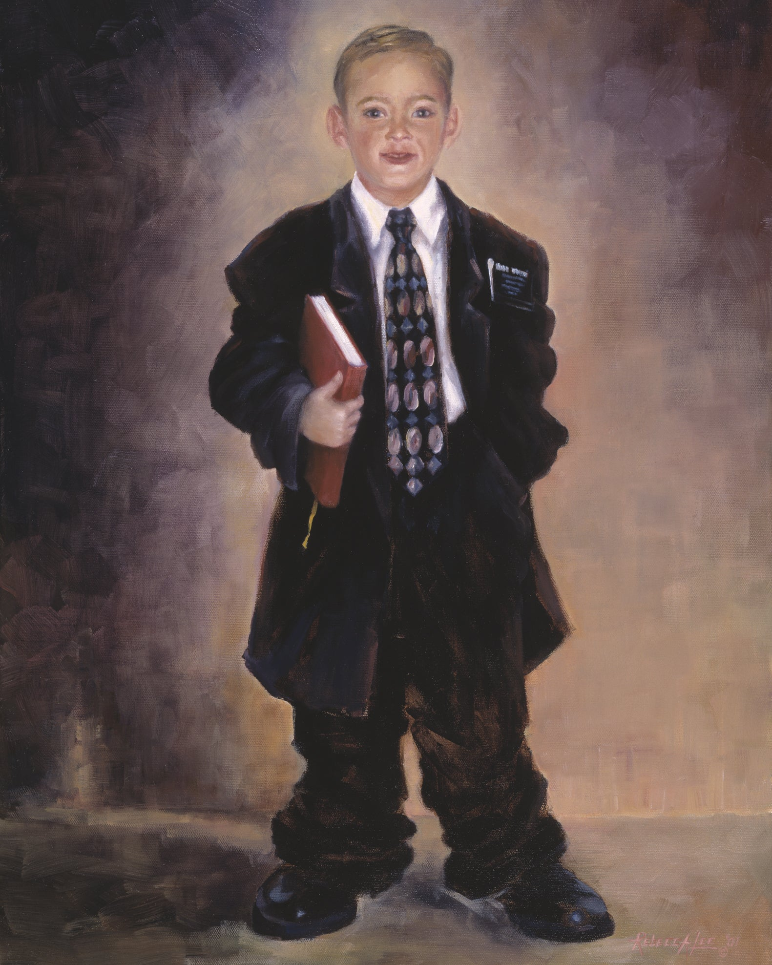 Young boy dressed in a baggy suit as a missionary holding a book of Mormon.