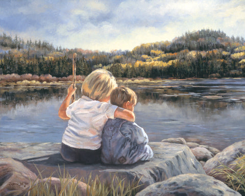 Two young children sitting on a rock looking out at a lake.