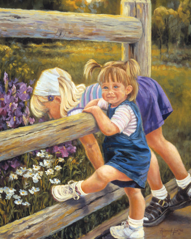 Two young girls leaning over a fence looking at purple flowers.