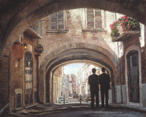 Two elder missionaries walking under an arch in a European Street.