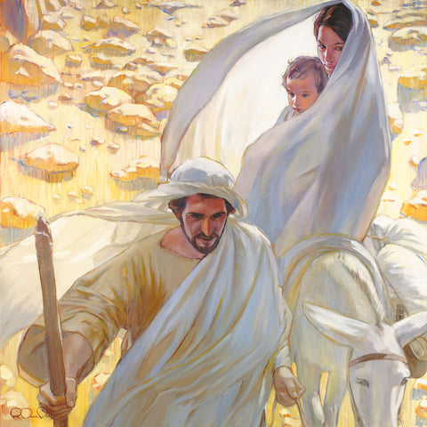 Joseph leading Mary and young Jesus on a donkey though the desert.