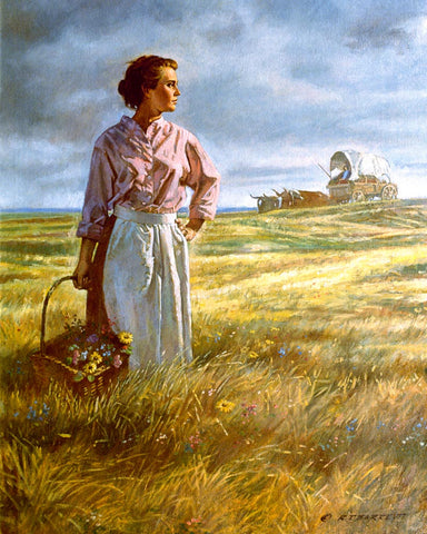 A pioneer women holding a basket of wildflowers in a field with a covered wagon in the background.