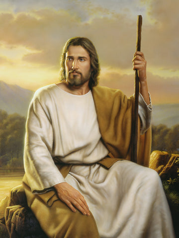 Christ seated on a rock holding a staff represents strength and compassion.