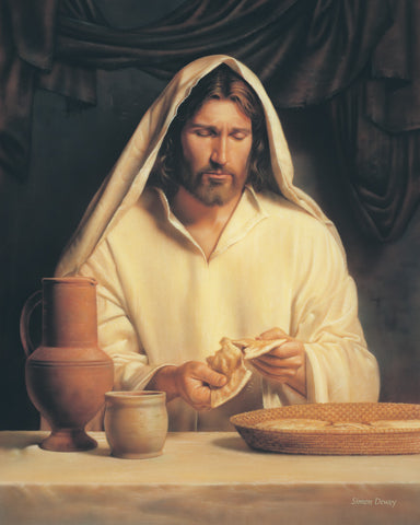 Christ preparing the sacrament by breaking bread for the last supper.