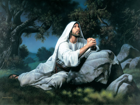 Christ kneeling at night in the garden of Gethsemane and praying.