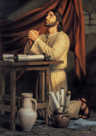 Jesus kneeling beside a table praying surrounded by scripture scrolls.