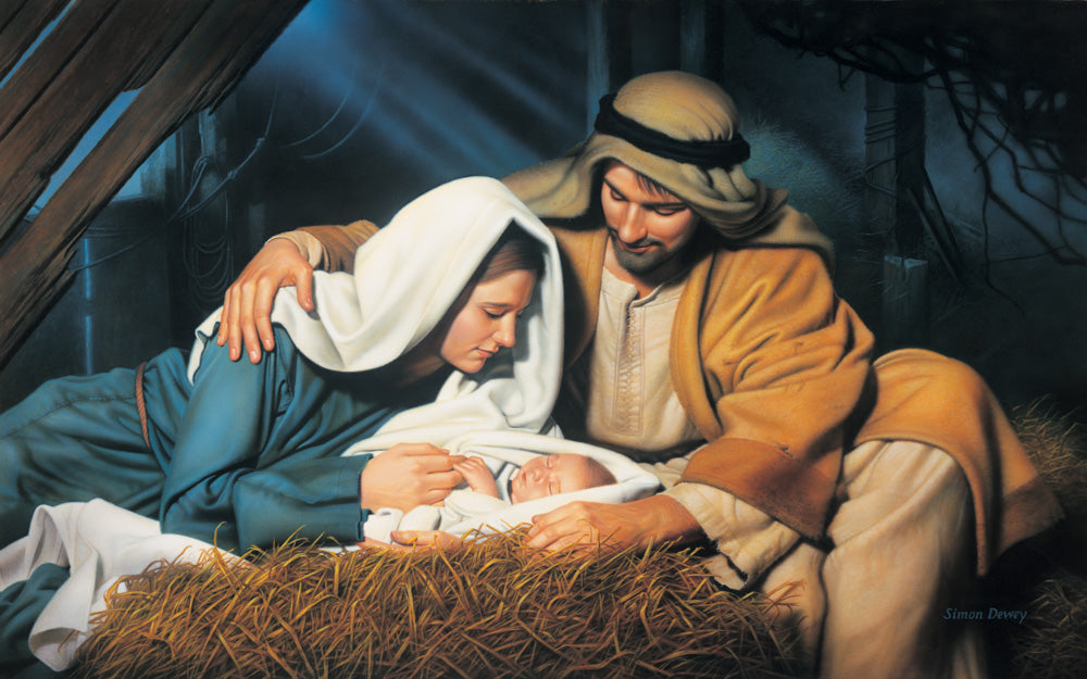 Joseph and Mary look at baby Jesus as he sleeps in the manger.