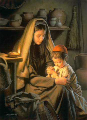 The boy Jesus kneels beside his mother Mary as they pray together.