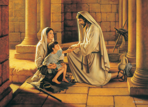 Jesus heals a young boy who is sitting on his mother's lap.