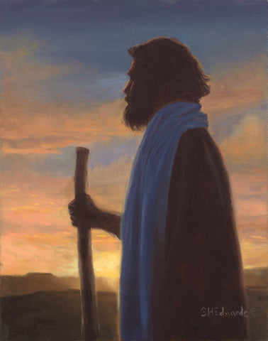 Jesus Christ as the good shepherd standing with a staff at sunset.