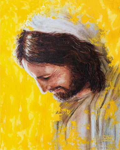 Portrait of Jesus surrounded by yellow light.
