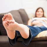 Pregnant person with feet up, resting during Braxton Hicks, Bundle of Joy Blog pregnancy tips for false labour