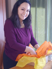 Owner Winnie packing a box, Canadian pregnancy & postpartum subscription boxes, Canadian made products