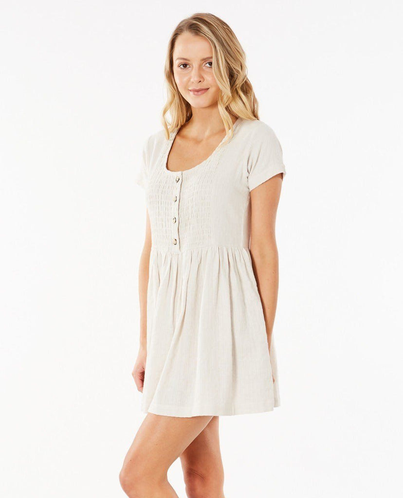 Rip Curl Santana Dress is a linen/cotton blend with shirring front button detail.