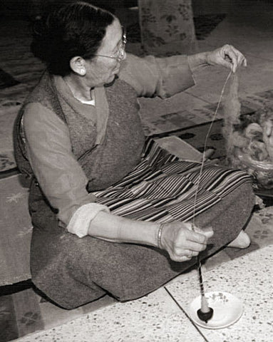 hand spinning wool for a handmade rug in nepal