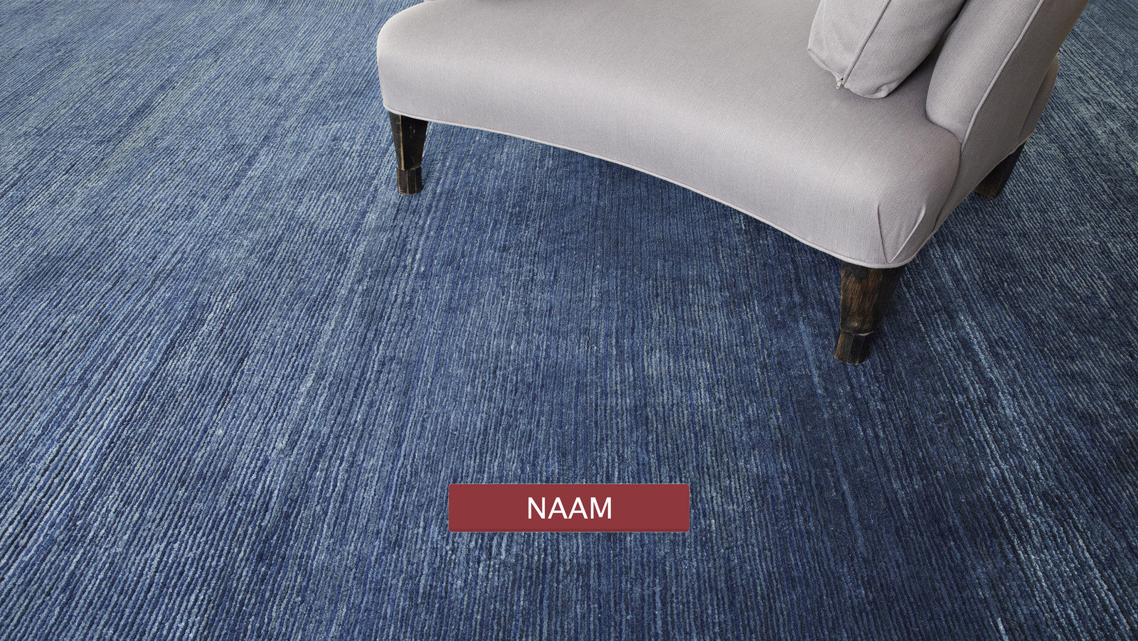 Naam is a museum quality rug handmade with handcarded himalayan wool and indigo vegetable dyes