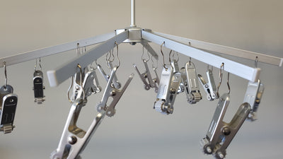 TopLine Umbrella Hanger showing stainless steel clothes pegs attached ready for use