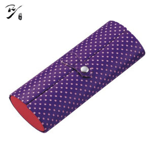 Oval blue spectacle case with white dots